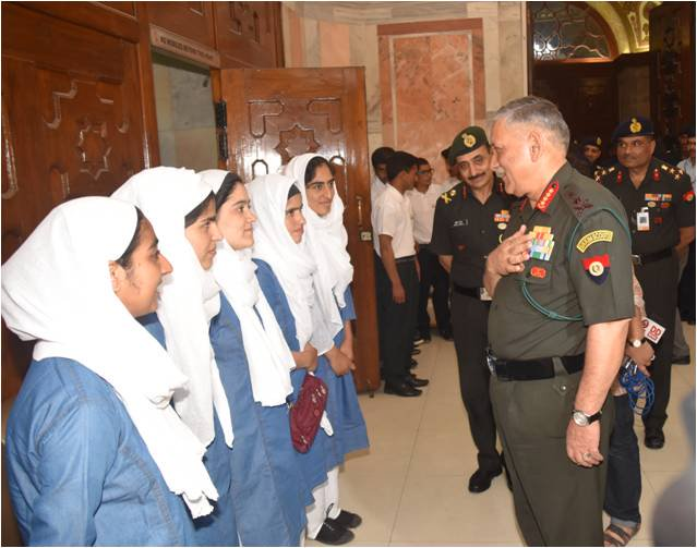 Gen Rawat interacting with the girls
