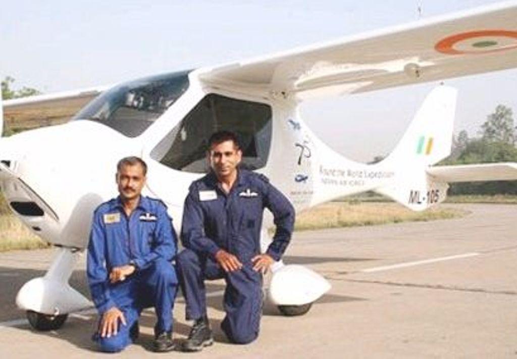 Wg Cdr Rahul Monga and Wg Cdr Anil Kumar with their microlight