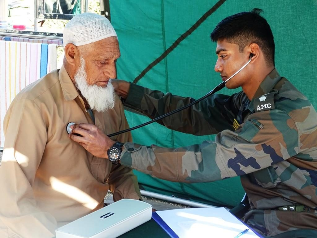 Army Medical Corps Officer Providing Aid To An Elderly Kashmiri Resident