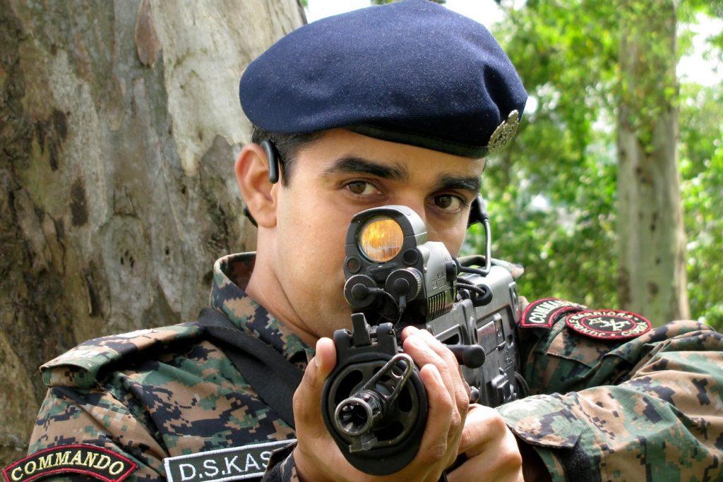COBRA soldiers taking aim with Israeli X95
