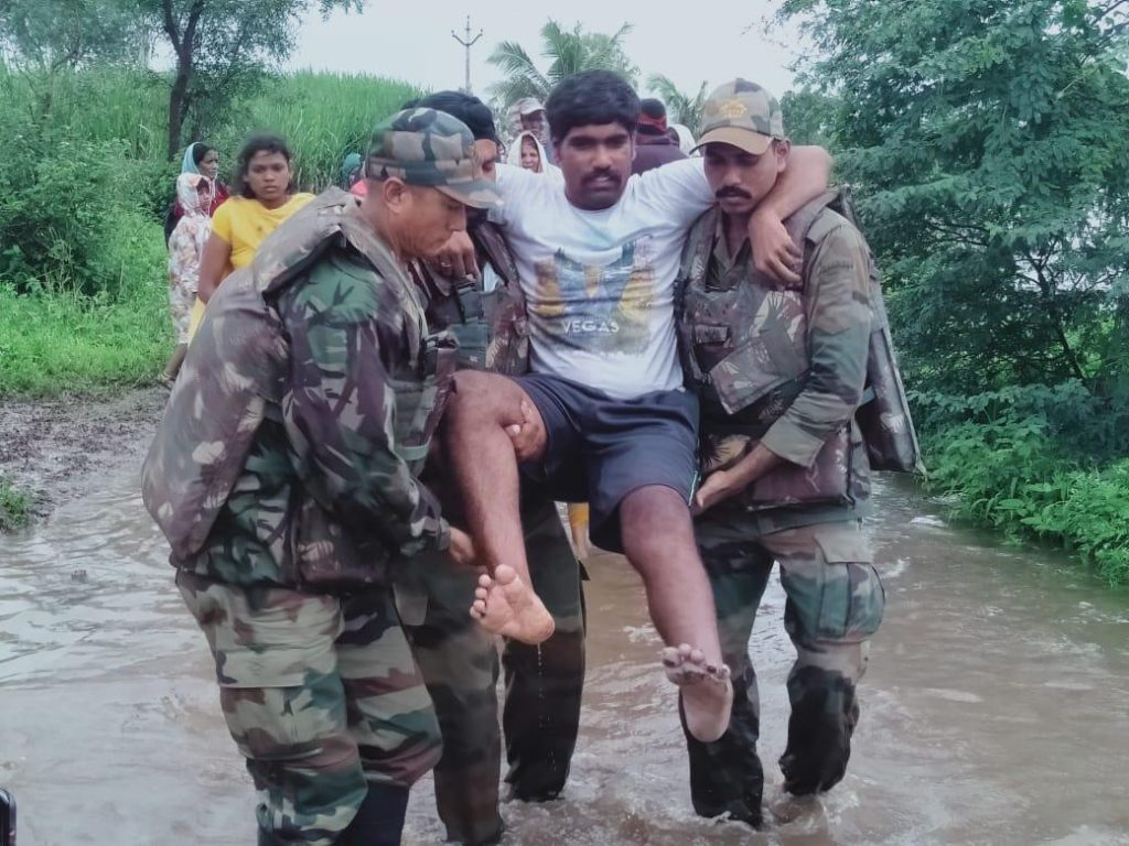 Soldiers evacuating injured local