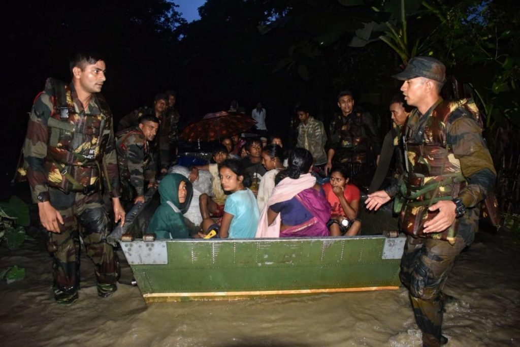 Locals being evacuated in makeshift boats