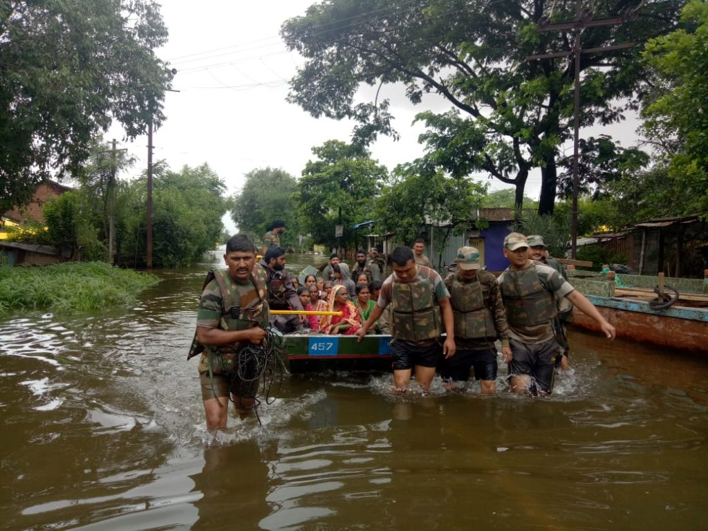 Women being evacuated by Indian army personnel