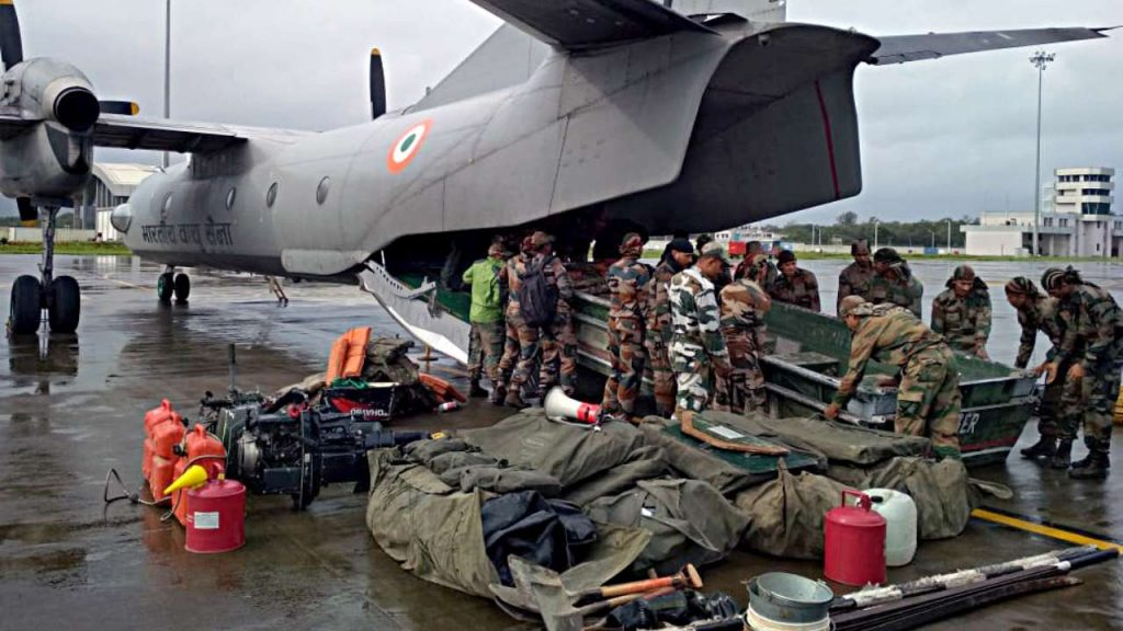 Indian army personnel receiving rescue boats from an IAF aircraft